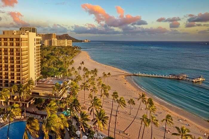 A sunset shot of the Ali-i Tower at the Hilton Hawaiian Village Waikiki Beach Resort in Honolulu
