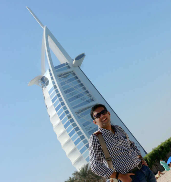 Standing before the grand Burj Al Arab hotel in Dubai