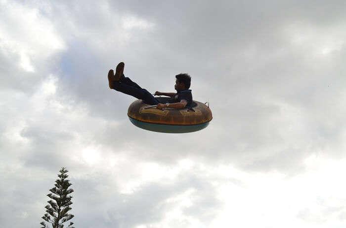 Man enjoying a flying tube ride in Mauritius