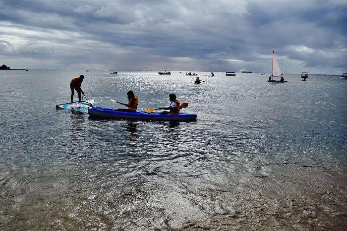 Couple enjoying kayaking in Mauritius