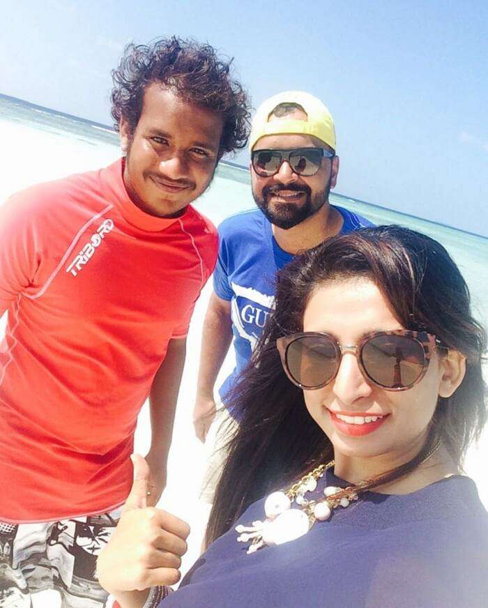 Mubashir and his wife with their scuba diving teacher in maldives