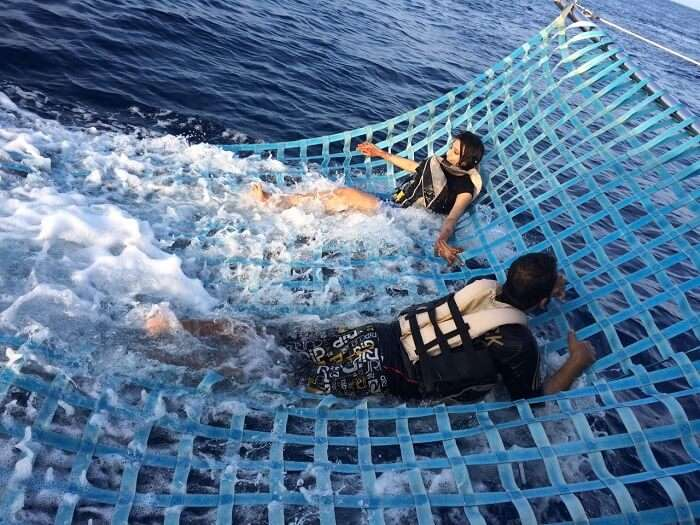 Mubashir and his wife enjoy activities on the nets on the sunset cruise