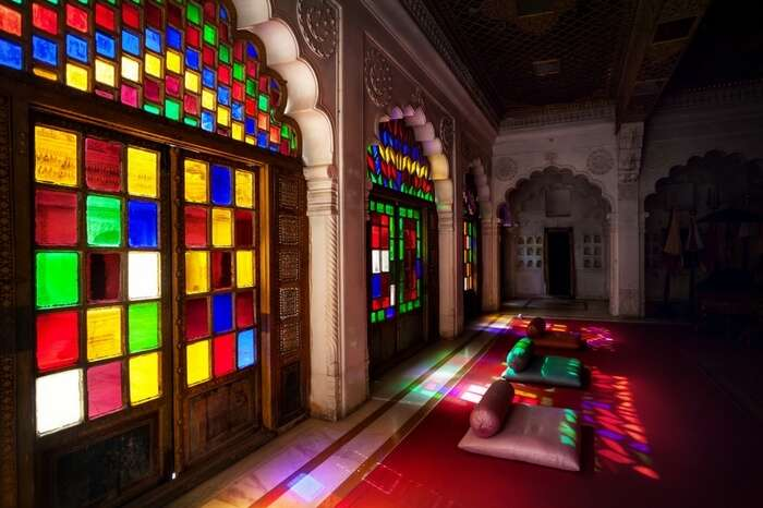 Colorful mosaic windows and doors in the emperor hall of Mehrangarh Fort