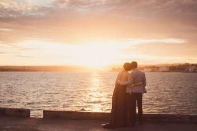 Couple watching a romantic sunrise