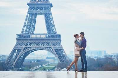 Couple romancing near Eiffel Tower Paris