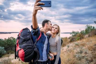 romantic couple taking selfie on honeymoon