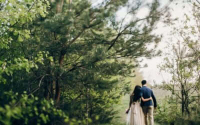 A couple walking in a forest