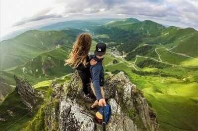 A daring couple on mountain top