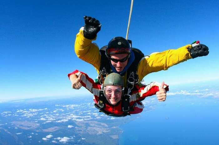 Skydivers during a freefall over Lake Taupo in New Zealand