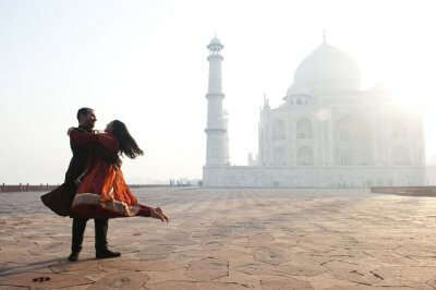Couple spending romantic time together at Taj Mahal