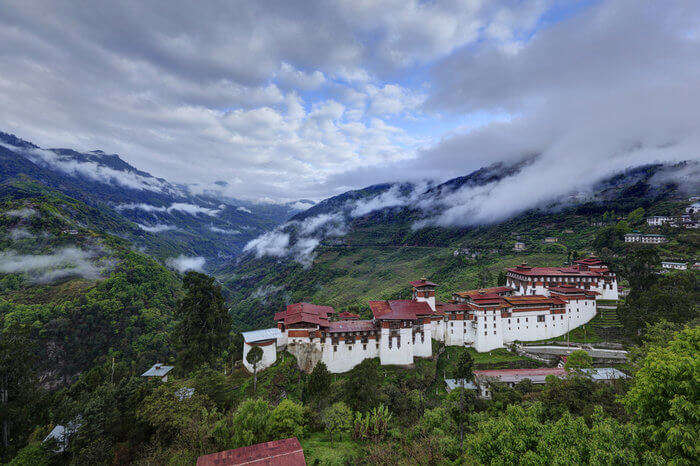 Bumthang monastery and mountains surrounded by clouds