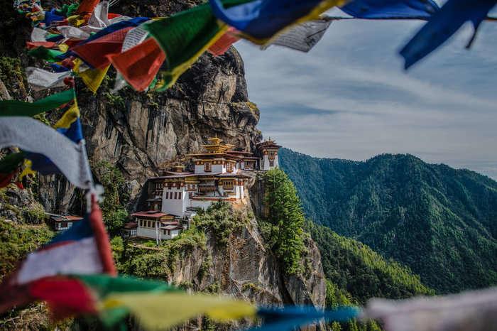 Prayer flags fluttering at Taktsang monastery