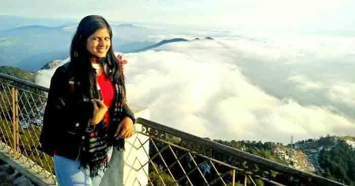 Shweta posing for a photograph in Kanatal