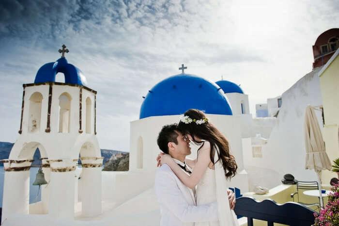 Romantic couple on a honeymoon in Santorini in Greece
