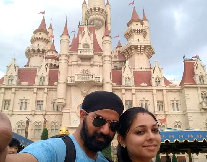 taking a picture outside the castle in universal
