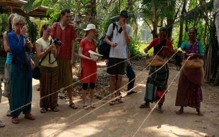 Tourists learning the village culture during an ecotour in a village in Kerala