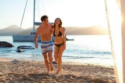 Couple on a beach during honeymoon in Australia