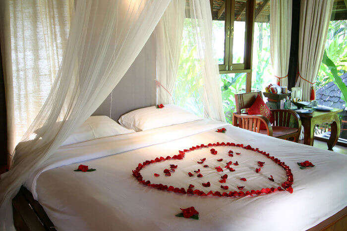 a bed decorated with rose petals