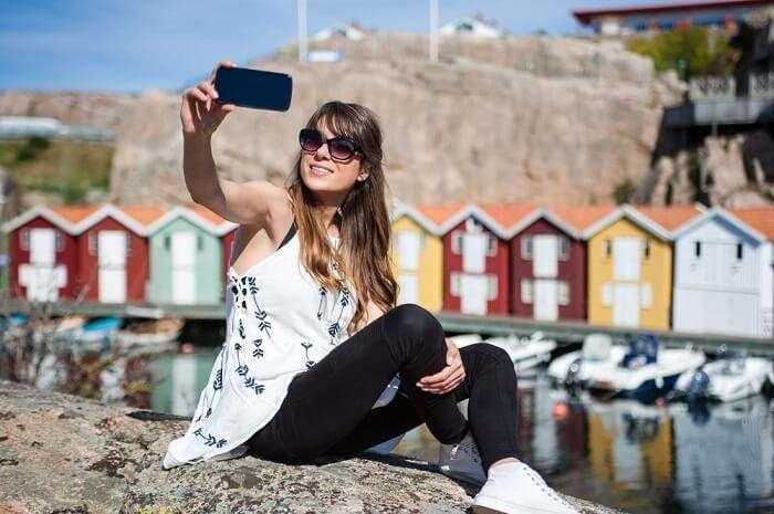 a girl clicking selfie in Sweden