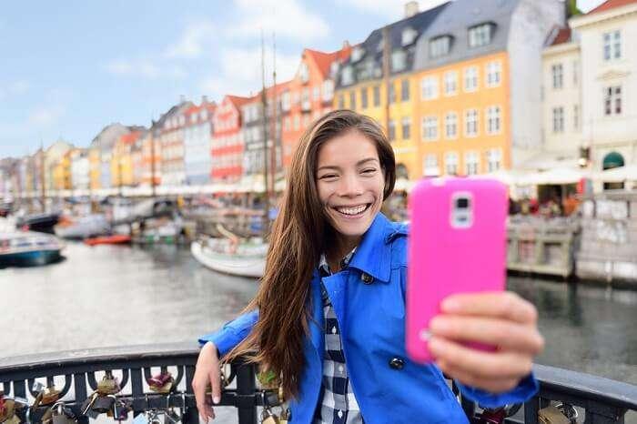 A girl clicking selfie in Denmark
