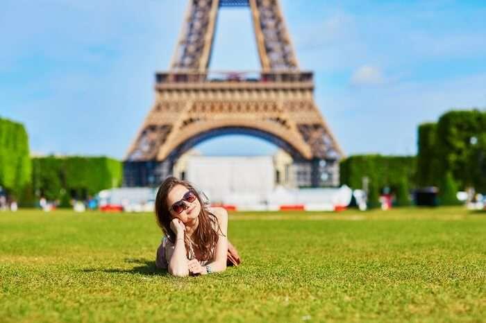a girl posing near Eiffel Tower Paris