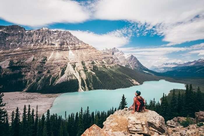 solo female traveler trekking on the Canadian rockies
