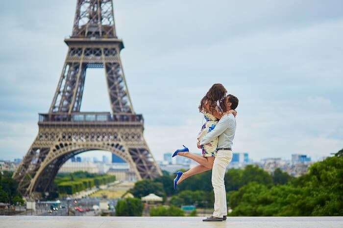 Loving couple having a date near the Eiffel tower in France
