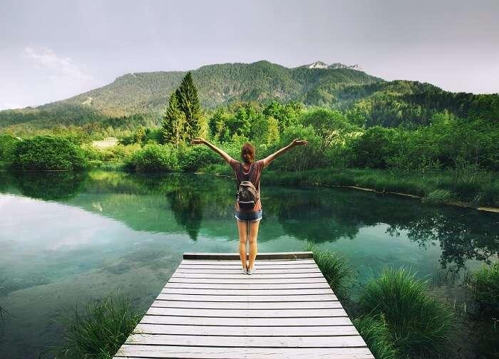 solo female traveler admiring nature in Slovenia