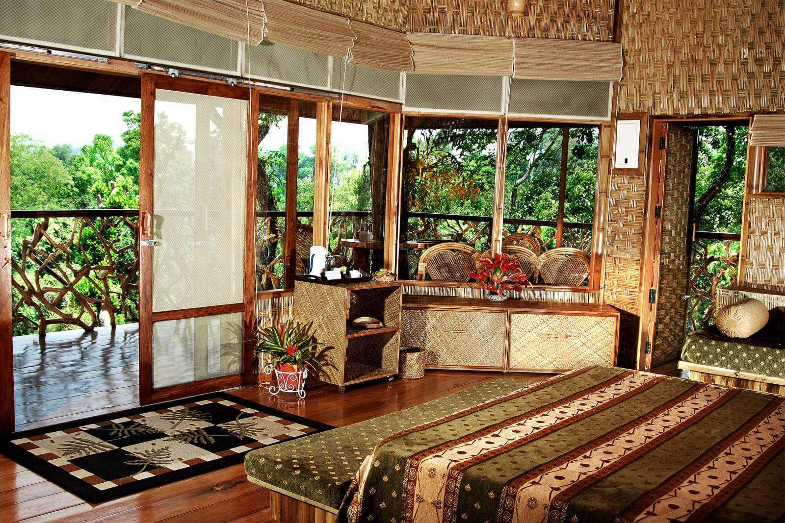 a resort room with glass window