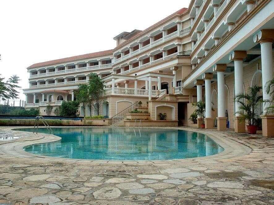 an outdoor pool of a resort in Lonavla