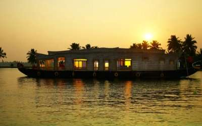 A houseboat in Kumarakom in Kerala at sunrise