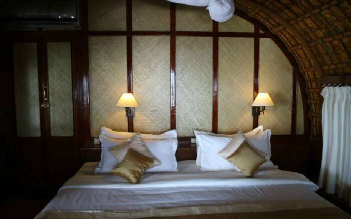 A well laid-out bedroom of Spice Coast Cruises in Alleppey