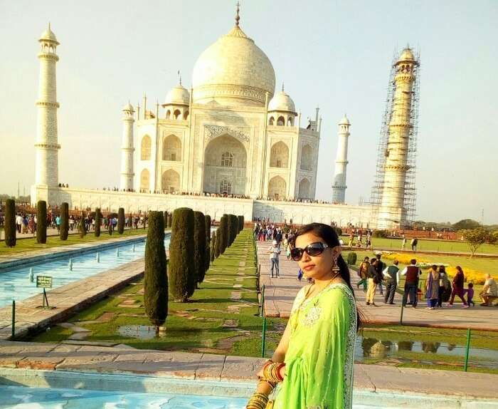 posing infront of one of the seven wonders