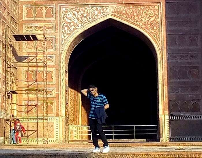 posing around monuments in Agra