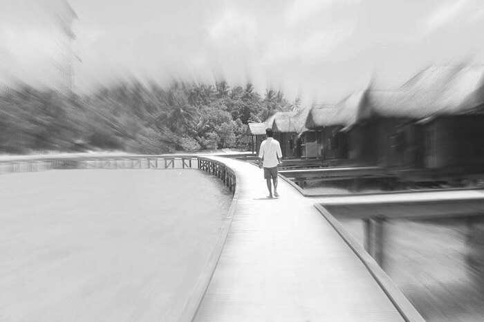 man walking fihalhohi island maldives
