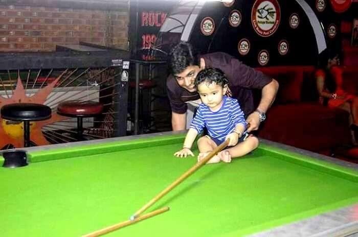 nishant and his son in a candid photo
