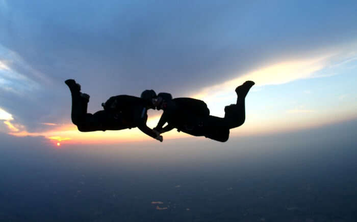 A couple kissing while skydiving