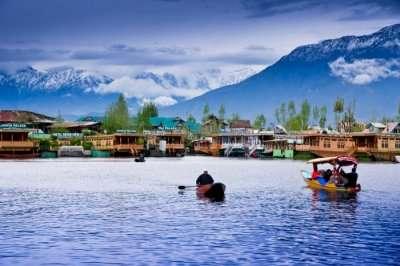 Shikara infront of a houseboat in Kashmir