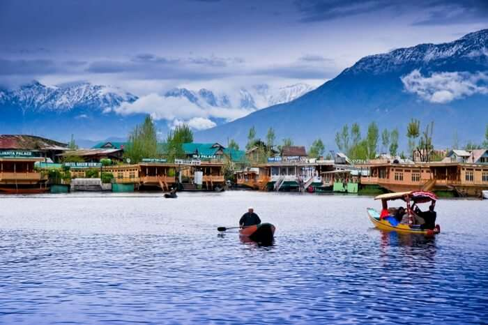 Shikara infront of a houseboat in Kashmir