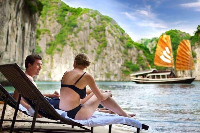 A couple relaxing by the Halong Bay in Vietnam