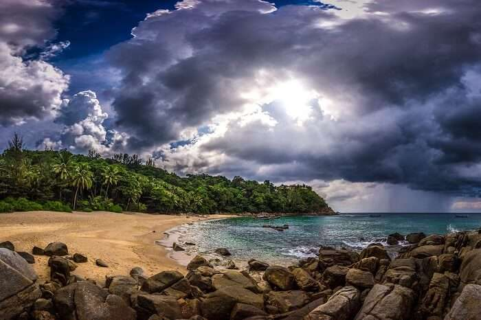 A beautiful shot of the cloud-covered sky over the Banana Rock Beach in Phuket
