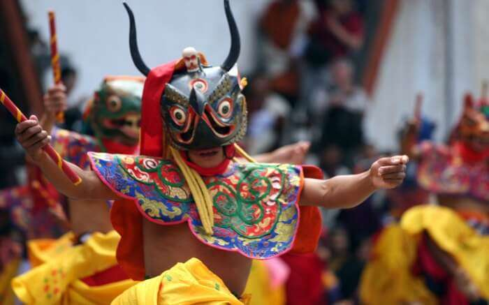 man wearing mask and performing during Sikkim summer festival