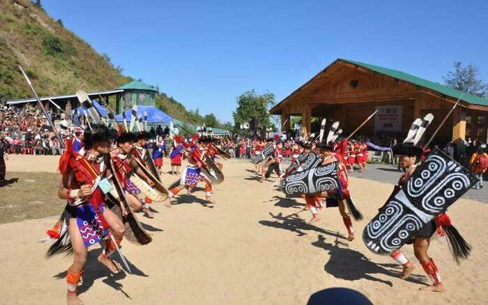 people of Nagaland wearing traditional clothes and performing