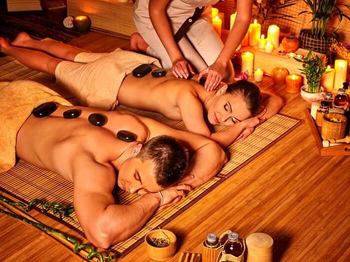 A couple luxuriates in bamboo spa