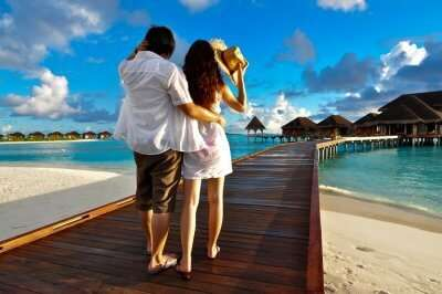 Couple on a pathway of luxury resort in Maldives