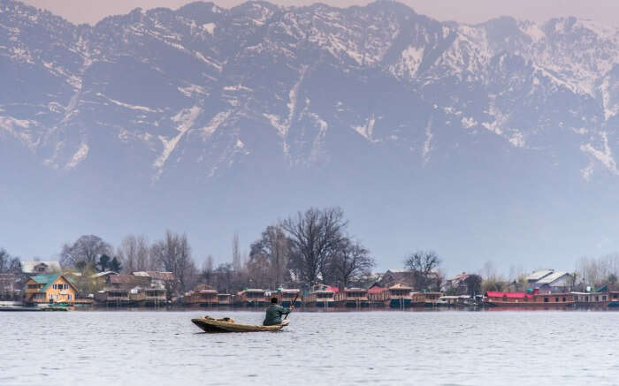 A boat crossing Nigeen lake in Srinagar in Kashmir