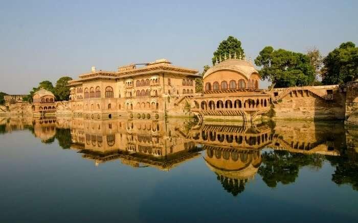 Deeg Palace reflection on lake water