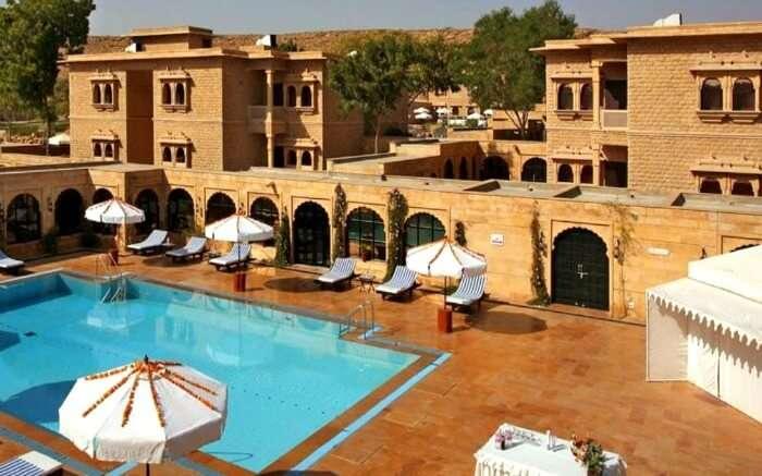 Gorbandh Palace pool area with cabanas around