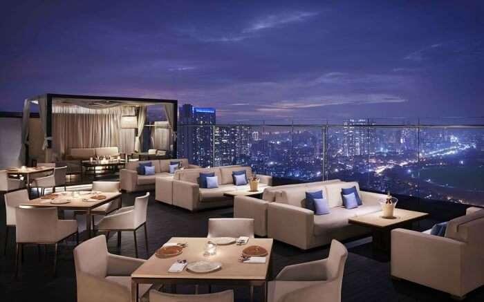 Rooftop seating area of Asilo facing Arabian Sea in Mumbai
