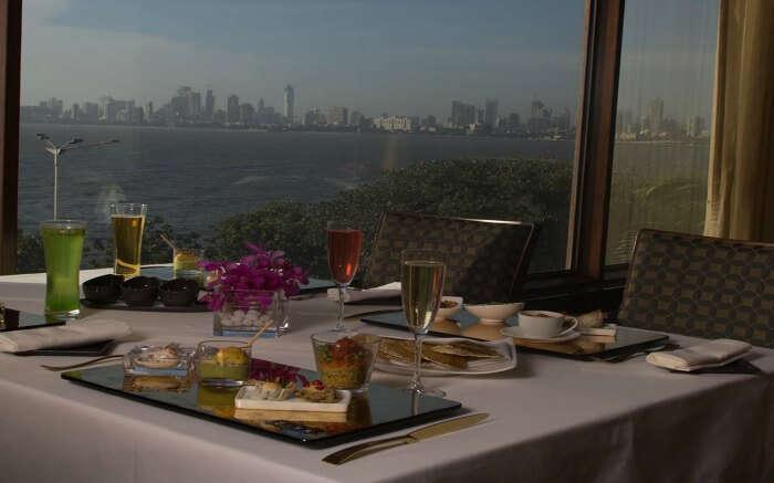 Well laid dining table at Ziya - The Oberoi facing sea in Mumbai